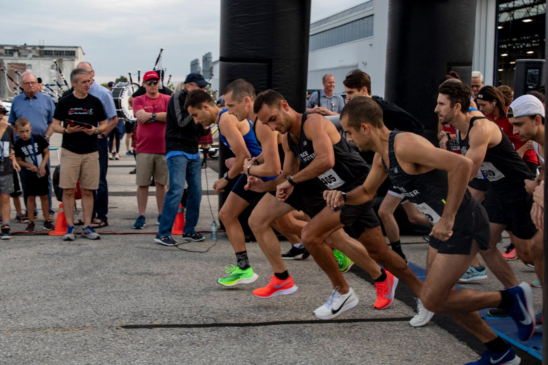 A group of men in colourful shoes get into starting position for Jordan's Run.